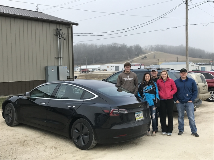 Students pose with Dr. Osterhaus' Tesla